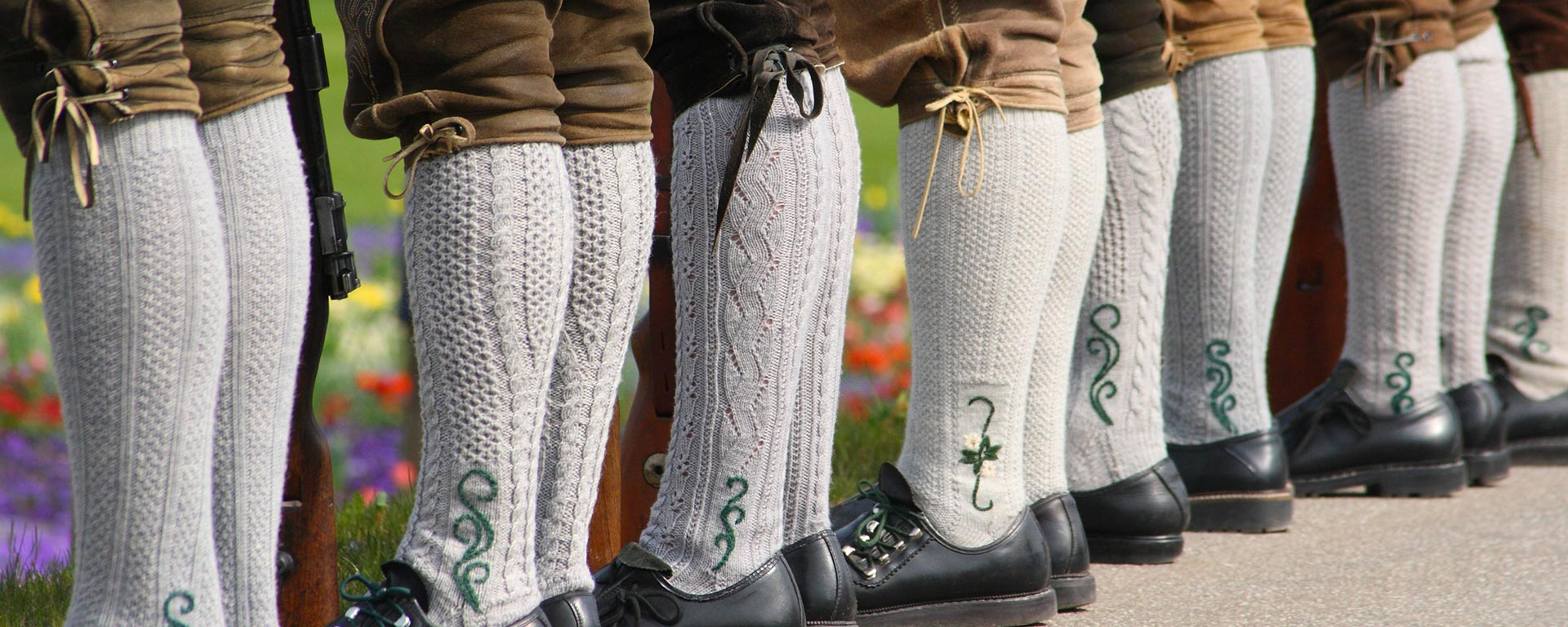 close up picture of some men's traditional shoes and socks during a folk festival in San Vigilio di Marebbe